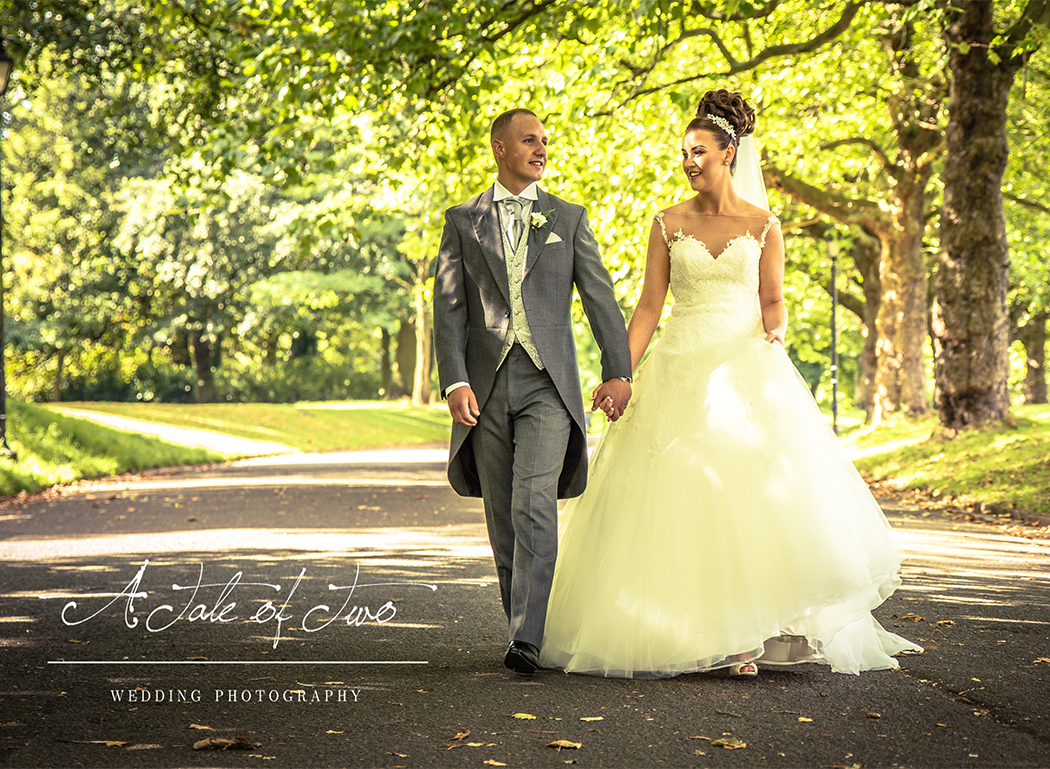 Bride and Groom by the car in Sefton Park, Liverpool for Danielle and Alan`s wedding...for booking info please visit www.ataleoftwo.co.uk