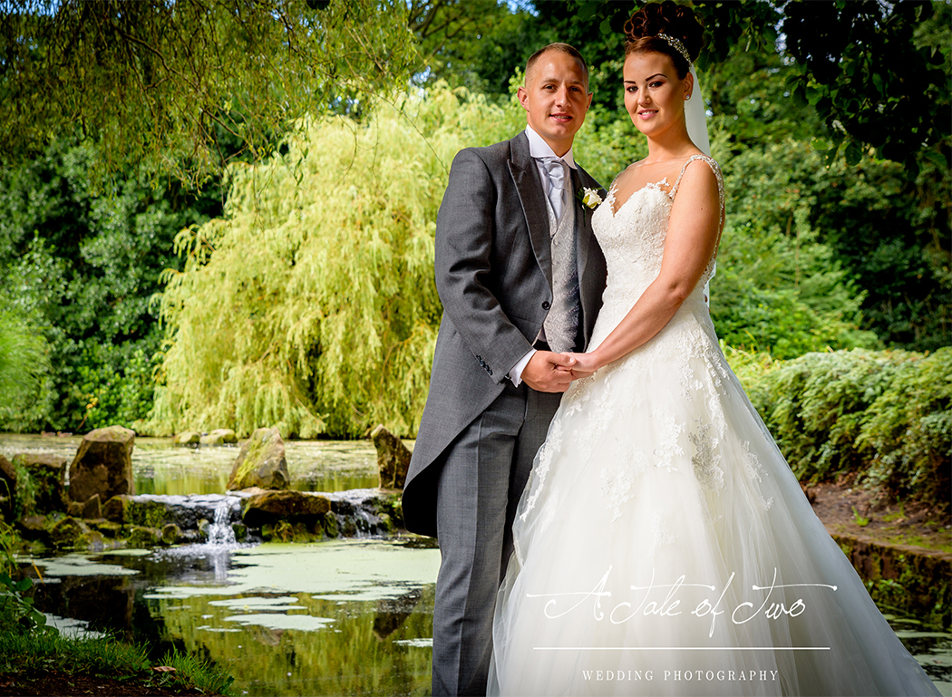 Bride and Groom under the trees in Sefton Park, Liverpool for Danielle and Alan`s wedding...for booking info please visit www.ataleoftwo.co.uk