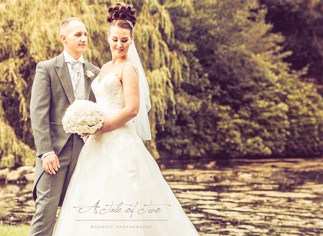 Bride and Groom taken by the lake in Sefton Park, Liverpool for Danielle and Alan`s wedding...for booking info please visit www.ataleoftwo.co.uk