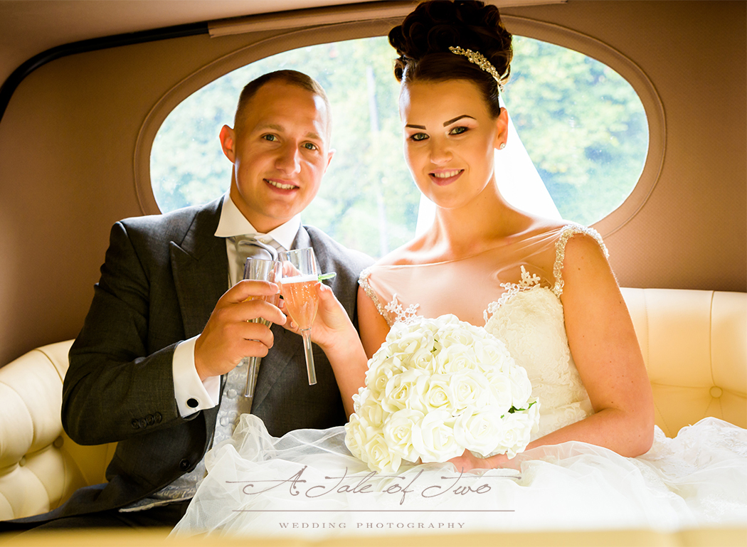 Bride and Groom inside the car at Sefton Park, Liverpool for Danielle and Alan`s weddng...for booking info please visit www.ataleoftwo.co.uk