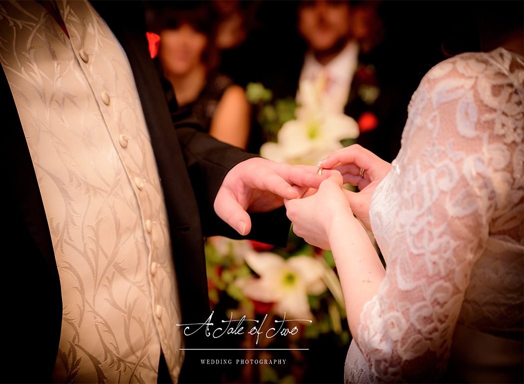 Bride and Groom exchanging rings at Styal Lodge, Cheshire for Debbie and Dean`s wedding...for booking info please visit www.ataleoftwo.co.uk
