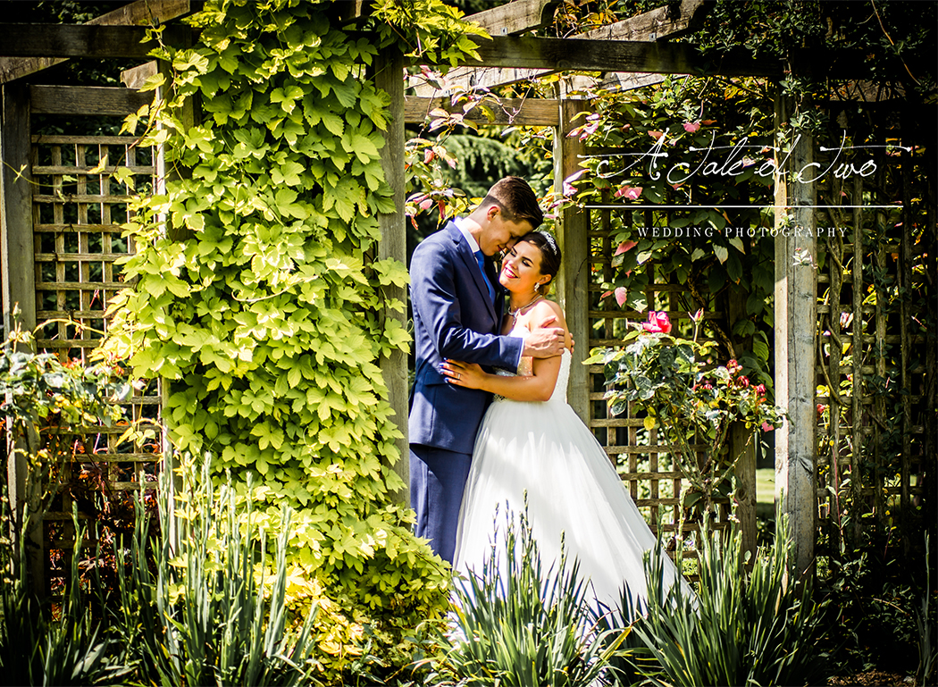 Kate and Nathan on their wedding day in the gardens of Mottram Hall, Cheshire...for booking info please visit www.ataleoftwo.co.uk