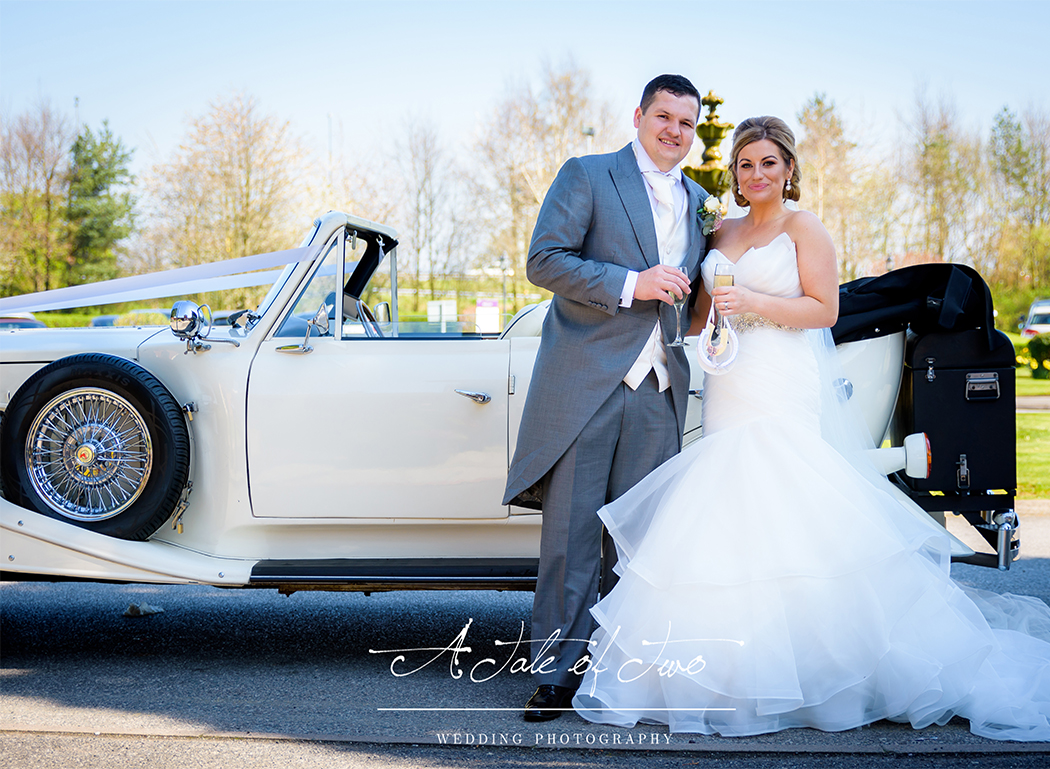 Bride and Groom by the car at The Mercure Haydock Hotel, Warrington for Natalie and Ben`s wedding...for booking info please visit www.ataleoftwo.co.uk
